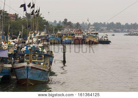 Negombo, Sri Lanka - November 30: Local Fishermen And Their Boats In The Lagoon Near The Fish Market