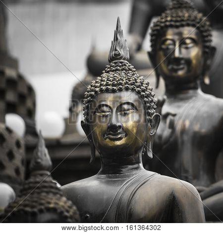 Row Of Buddha Statues At Ganagarama Temple, Colombo, Sri Lanka. Black And White.yellow Selective Col