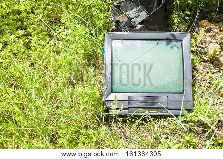 Old television CRT abandoned in a illegal dump