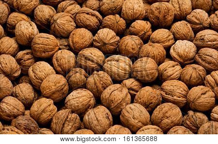 Pile of walnuts in shell. Close up. top view.