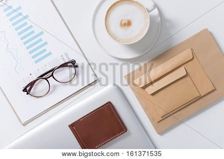 Statistical data. Flat lay of stylish eyeglasses lying on important statistical data documents