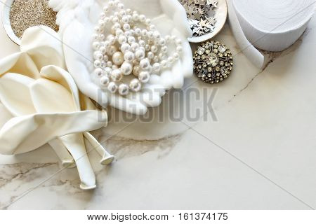 Chic ivory and white bridal accessories frame desk top with room for copy.