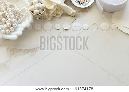 Chic ivory and white bridal accessories frame desk top with open space for copy.