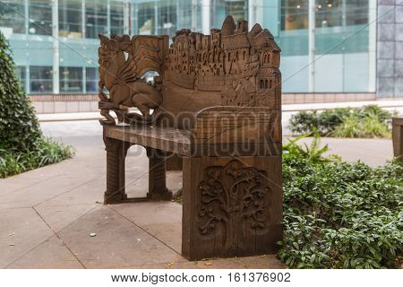 Old carved bench in the heart of the city of London - open park area