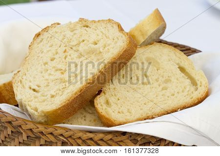 Bread In Basket. Slices Roll Breads In Basket On Table
