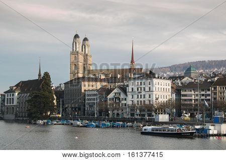 ZURICH, SWITZERLAND - DECEMBER 11, 2016: View of the Grossmunster (great minster) Church and the Limmat River in Switzerland