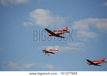 group small aircraft in the sky fly