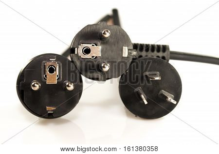 Three black electric plugs isolated on white background