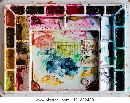 Multi colored water color painting palette mixing tray used to create shades of colour