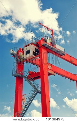 Red Gantry Crane Detail Against Blue Sky. Industrial Crane In Santa Cruz De Tenerife Port