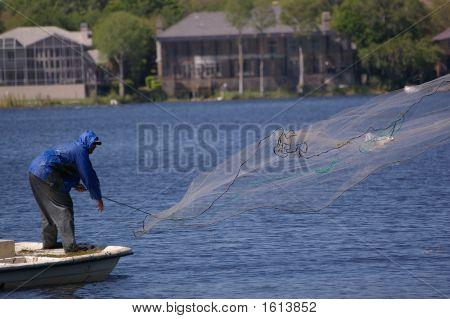 Fisherman Throwing A Net