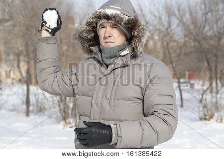 The Guy's Portrait With The Snow In Hands