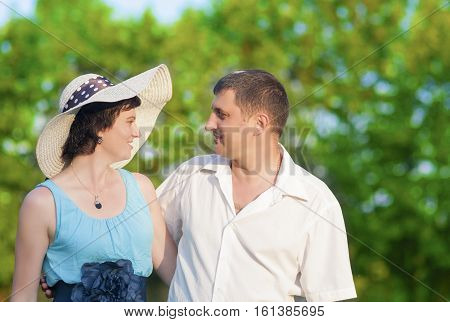 Family Values Concepts and Ideas. Two Caucasian Mature Adults Enjoying Together Outdoors. Walking Embraced in Park. Horizontal Image