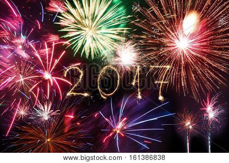 Happy New Year 2017 Written With Sparkle Firework On Black Background,