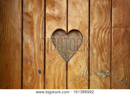 One Heart Shape Carved In Vintage Wood Close Up