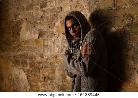 Drug addict looking dependent from different types of drugs. Drugs concept. Addict, breaking, pain, depression, drama, illness