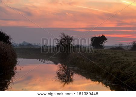 December dawn breaking over Pevensey Levels in East Sussex England