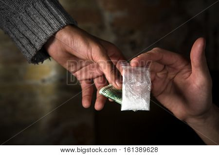 Money and narcotics concepts. People buying narcotics. Drug dealer selling narcotics to people. Drugs concept.