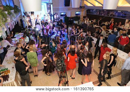 Kyiv Ukraine - December 29 2014: People dancing and clubbing on the party in Night club in Kyiv on December 292014. Many People having fun at the Party in full swing with crowded dancefloor in disco entertainment night club