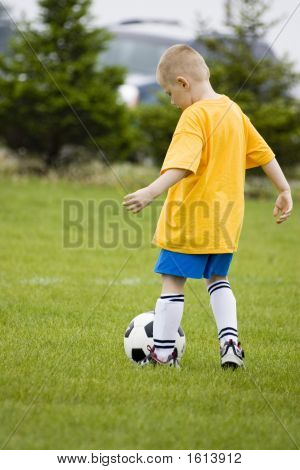 Young Boy Learning How To Play Soccer