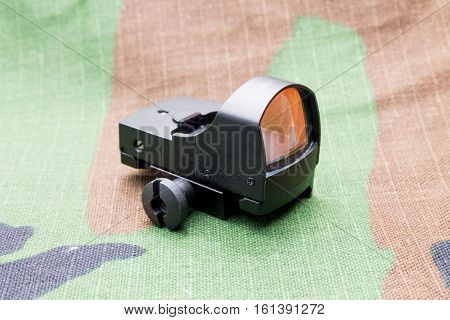 Collimator sight rear view on camouflage background. poster