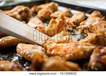 Cooking Tongs Holding Bbq Chicken Wings