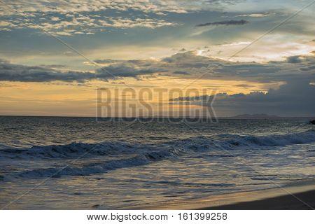 Panorama of beautiful sunset on the sea.