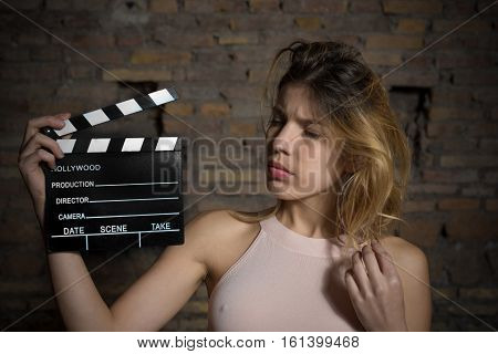 Young Blonde Girl With Movie Clapper