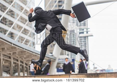 Motion Blur Of Businessman  Holding Bag And Running Rapidly To Airport In Formal Suit. In Rush Hour