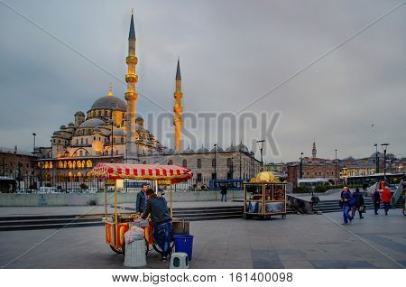 Istanbul Turkey - March 14 2013: New Mosque (Yeni Cami) Istanbul Turkey. The Yeni Cami ; originally named the Valide Sultan Mosque and later New Valide Sultan Mosque after its partial reconstruction and completion between 1660 and 1665; is an Ottoman impe