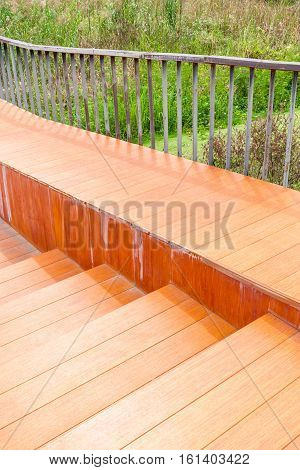 Wooden ramped access using wheelchair ramp for disabled people.