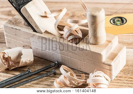 Old wooden jointer ruler and nails on table