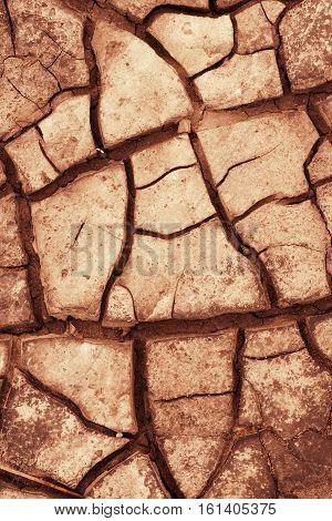 Cracked land. Toned close up natural texture