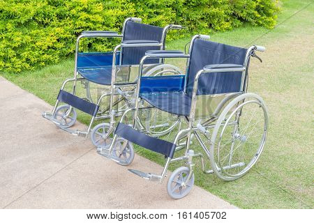 Empty wheelchairs service in the public park.