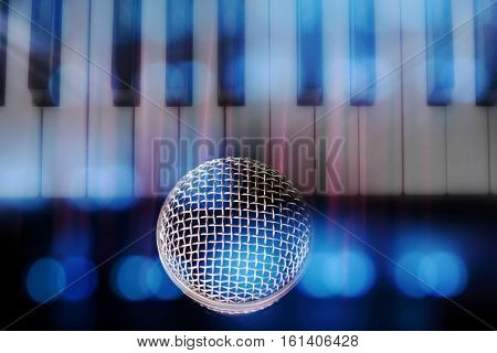 classical microphone and blurred keyboard background music contest