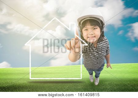 Little engineer, childhood construction architecture building and people concept on a green meadow