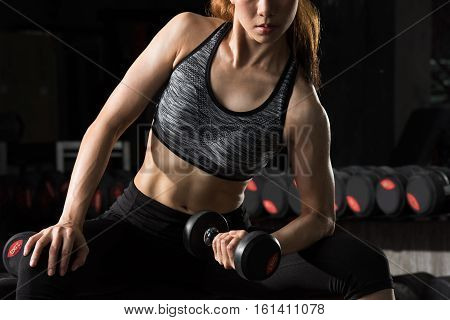 fitness woman,Asian woman lifting weight at fitness center.