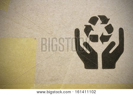Fine image close-up of grunge black fragile symbol on cardboard