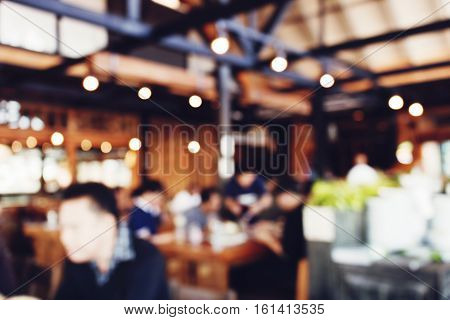 Coffee shop or restuarant with bokeh and blurred background with vintage tones.