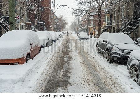 Cars covered in snow during snowstorm in Montreal December 2016.