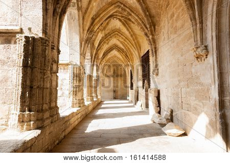 Arched cloister of historic Gothic architectural Cathedral Saint Nazaire Beziers France