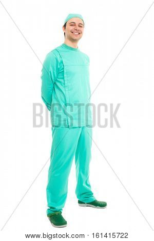 Full length portrait of a smiling surgeon. Isolated on white