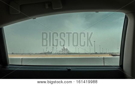 View from car window on the Mosque of Sheikh Zayed in Abu Dhabi, UAE.