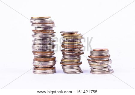 growing money graph on a three row of coin and pile of bath coins stack  on white background finance business isolated