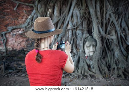 Tourist And Head Of Buddha In Thailand