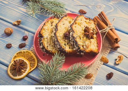 Vintage Photo, Fresh Baked Fruitcake For Christmas On Plate And Spruce Branches On Boards