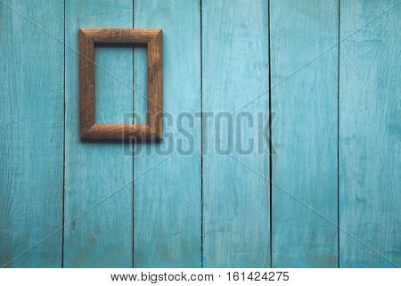 old wooden photo frame on blue wooden wall