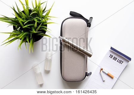 concept of electronic cigarette on white background top view - harm of smoking