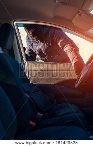 Thief Opening Car Window And Breaking Into Auto