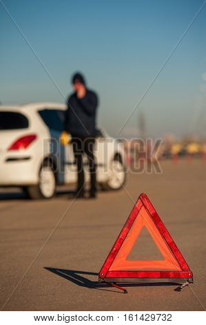 Male Driver Calling To Car Assiatance Outdoors